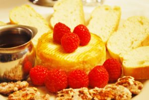 Honey Baked Brie with Candied Pecans, Raspberries & Toast